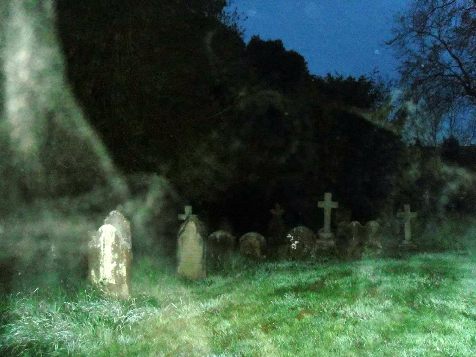 Terrified couple 'attacked' by a horde of GHOSTS as they walked through a graveyard