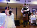 Bride and groom pipe themselves into their own wedding
