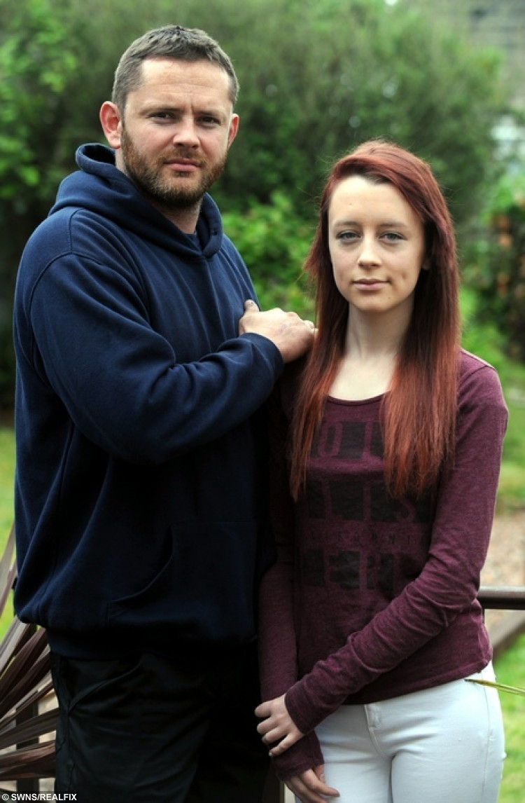 """Owen Thomas and his daughter, Leah, aged 16, who was sent home from college because of her red dyed hair. See SWNS story SWRED: A furious father has hit out after his daughter was sent home from school - after turning up with GINGER hair. Leah Thomas, 16, died her long naturally dark hair red before heading to classes at Ivybridge Community College. But the GCSE pupil was put in isolation and then sent home by teachers at the South Devon school until she changes her new do. The school has said she can come back to classes when her hair """"meets the published requirements""""."""