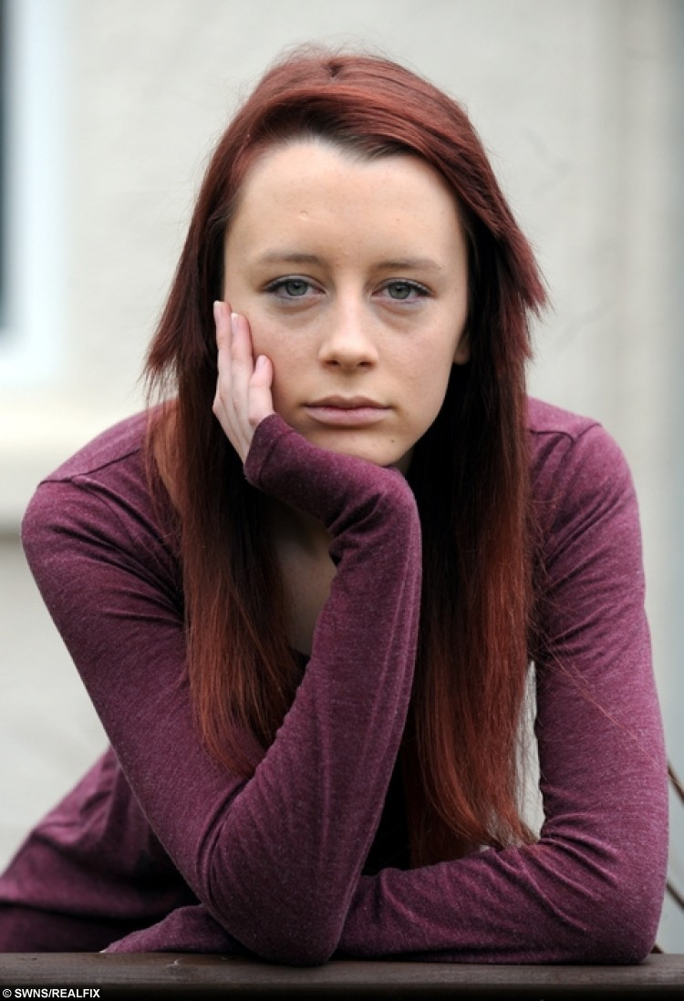 """Leah Thomas , aged 16, who was sent home from college because of her red dyed hair. See SWNS story SWRED: A furious father has hit out after his daughter was sent home from school - after turning up with GINGER hair. Leah Thomas, 16, died her long naturally dark hair red before heading to classes at Ivybridge Community College. But the GCSE pupil was put in isolation and then sent home by teachers at the South Devon school until she changes her new do. The school has said she can come back to classes when her hair """"meets the published requirements""""."""
