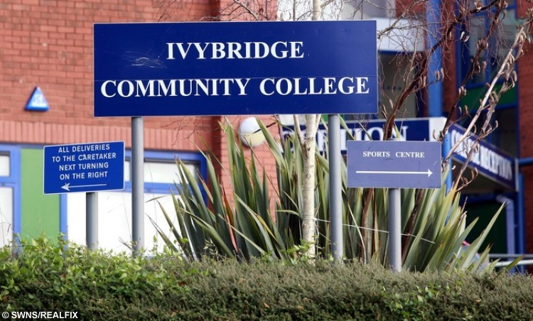 """The Ivybridge Community College in Devon. See SWNS story SWRED: A furious father has hit out after his daughter was sent home from school - after turning up with GINGER hair. Leah Thomas, 16, died her long naturally dark hair red before heading to classes at Ivybridge Community College. But the GCSE pupil was put in isolation and then sent home by teachers at the South Devon school until she changes her new do. The school has said she can come back to classes when her hair """"meets the published requirements""""."""