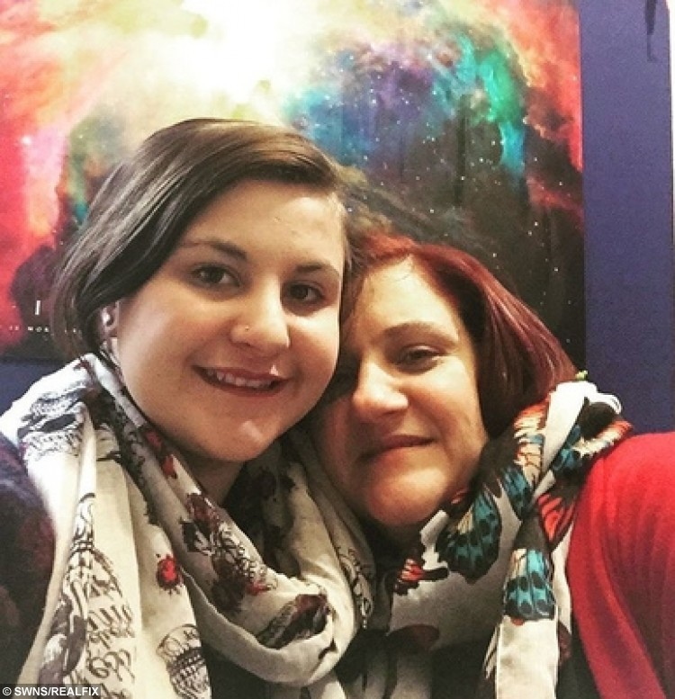 """Leigh Simons with her mother. A student who was vomited on at nursery school has spoken of the ordeal of uni life living with emetophobia, the fear of PUKE, but says she still has the occasional drink. See National story NNSICK; Leigh Simons (doub corr), 18, suffers with a severe manifestation of the phobia, which is thought to affect around one in 20 people in the UK. Now, in her first year as a psychology student at the University of Bath, Leigh fears she may never fully eradicate her fear, but is managing to live with it. She said: """"We had a party at nursery school - I was around three or four - and my friend was stuffing her face with fairy cakes when she threw up all over my dress."""