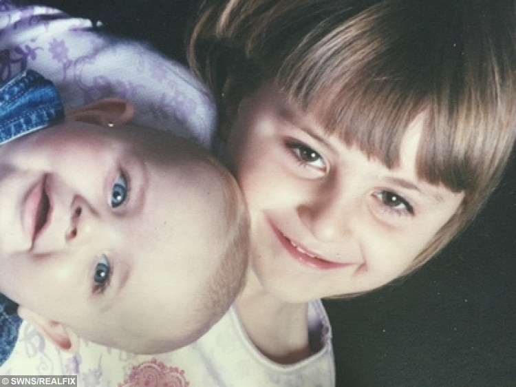 """Leigh Simons aged 4 with her younger brother Dean. A student who was vomited on at nursery school has spoken of the ordeal of uni life living with emetophobia, the fear of PUKE, but says she still has the occasional drink. See National story NNSICK; Leigh Simons (doub corr), 18, suffers with a severe manifestation of the phobia, which is thought to affect around one in 20 people in the UK. Now, in her first year as a psychology student at the University of Bath, Leigh fears she may never fully eradicate her fear, but is managing to live with it. She said: """"We had a party at nursery school - I was around three or four - and my friend was stuffing her face with fairy cakes when she threw up all over my dress."""