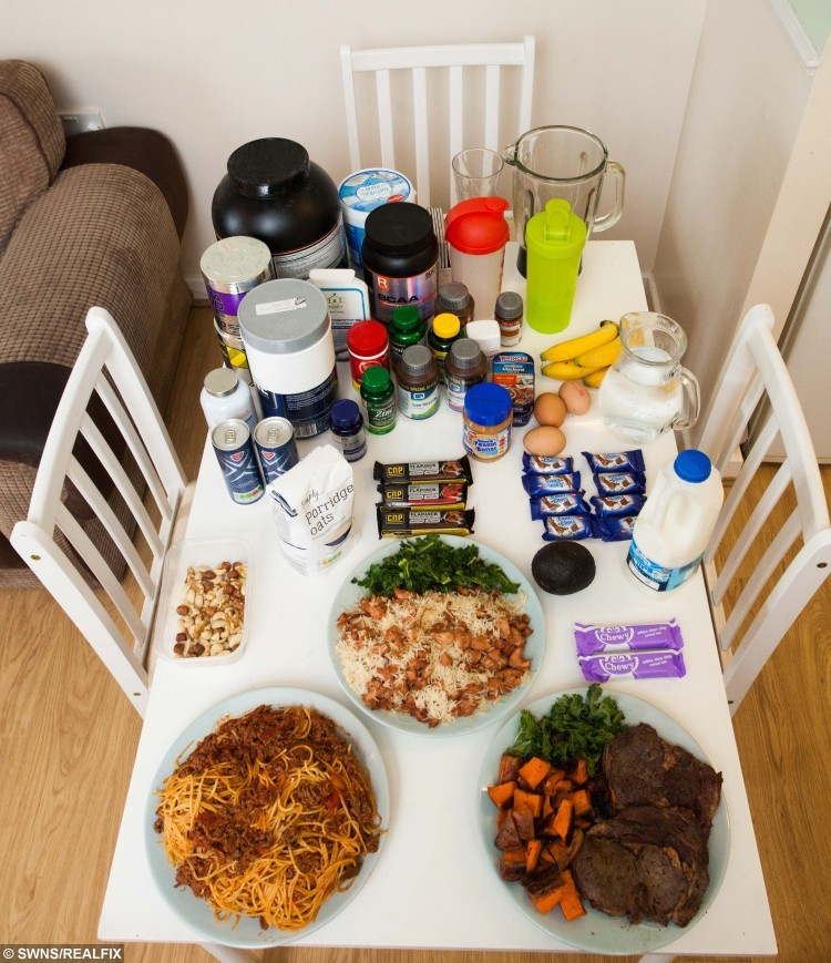 Sean Palmer's daily food intake. Sean consumes a daily diet of over 10,000 calories. See SWNS story SWSTRONG; A 24-stone strongman has revealed his 10,000 calorie-a-day diet - which includes a 2,500 calorie 'death shake' and enough steak to feed FOUR people. Sean 'The Bear' Palmer, who towers at 6ft 6ins, wolfs down gigantic meals in between his rounds as a postman - and even manages to fit in a mammoth four HOUR gym session. In a typical day, the 29-year-old shovels enough food into his mouth to feed a family, including a kilo of chicken, four portions of spag bol and three chocolate bars. He also glugs eight litres of water and a breakfast smoothie containing 2,500 calories, which makes his  daily calorie intake FOUR TIMES higher than the recommended limit.