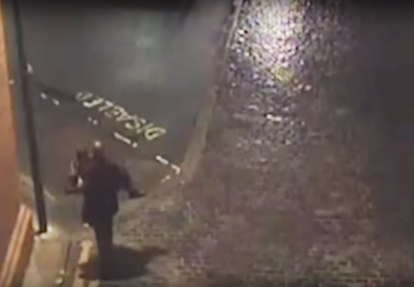 Police issue chilling footage of suspected rapist carrying his victim through city streets