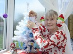 Wish it could be Christmas every day?  Meet the festive fan who celebrates the holiday all year round