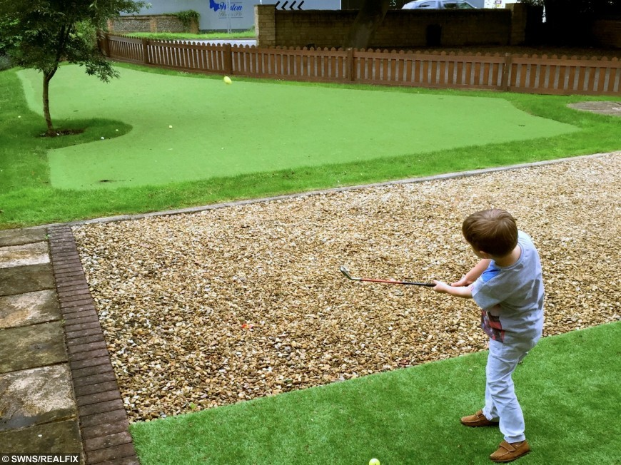 The putting green grass of home - dad builds son a golf ...