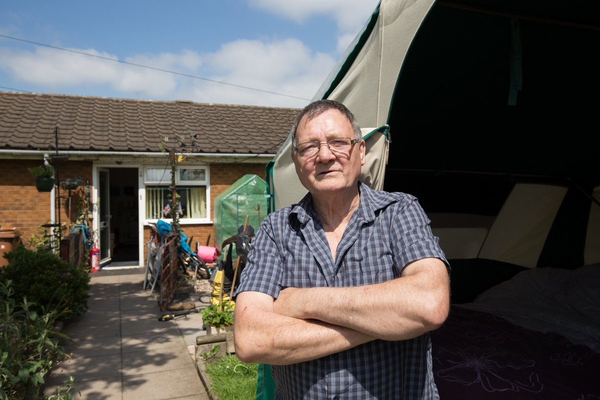 Disabled war veteran forced to live in TENT on his front garden while council finds his family a bigger home