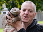Couple stun their neighbours by taking giant pet LIZARD for walks on a lead