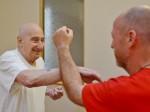 Grand-dad-Master – Zimmerframe wielding pensioner schools kids in Kung Fu