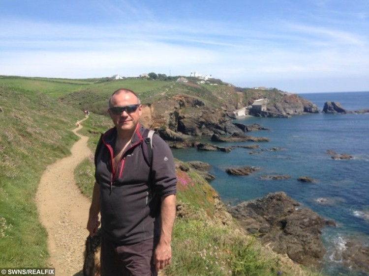 Nicolas Andre who was pictured saving a shark which was stranded near Lizard Point in Cornwall.