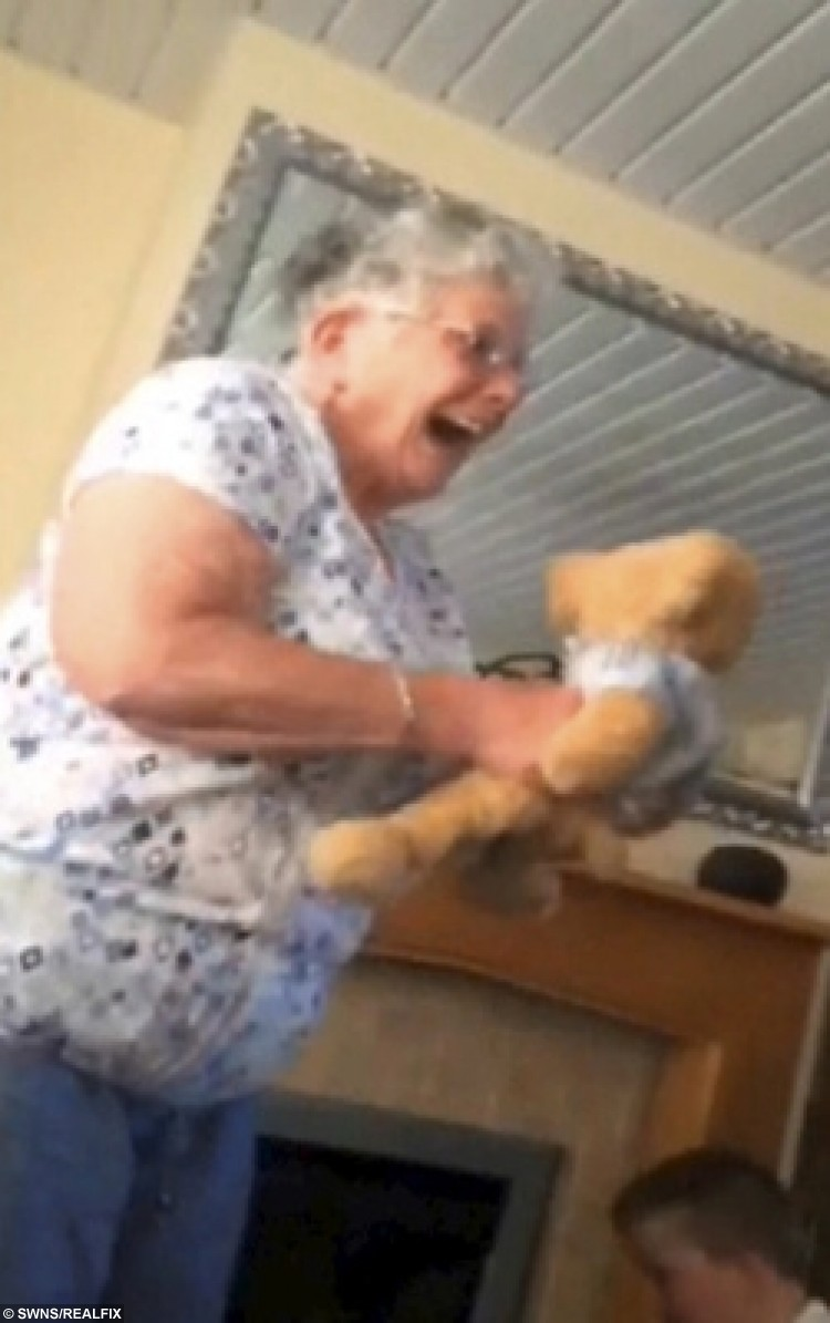 Jean Walters with her granddaughter Abbie Webb and the bear the teddy bear which has a chip with her late husband's voice in it