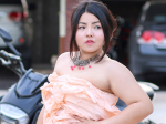 Wanna-be model becomes an internet sensation with a dress made of PRAWN CRACKERS