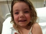 Brave little girl puts on a smile despite fighting the rarest form of leukaemia