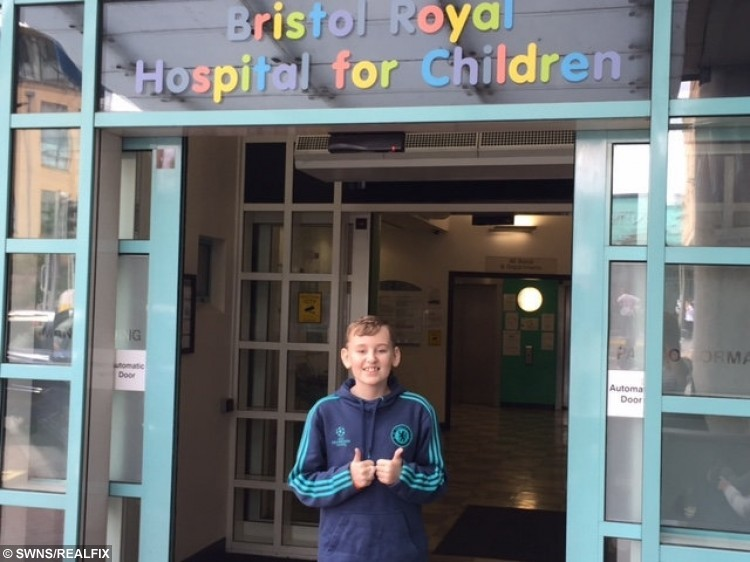 Daryl Allison outside Bristol Royal Hospital for Children before heading inside to start his second treatment for a super-rare cancer