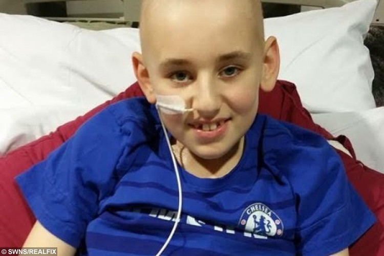 Collect photo of Daryl Allinson, 13, from Frome, Somerset, when he was in hospital in Bristol during his first treatment for a super-rare cancer.
