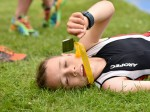 Inspirational schoolboy with cerebral palsy returns to secene of his first triathlon a year later to cross the finish seven minutes faster