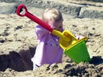Children told not to dig holes in the sand on beach