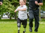 Schoolboy who lost both legs to meningitis back on feet with false limbs