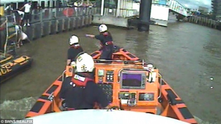 RNLI videograb from a rescue on the River Thames where Natalie Harrison held on to a girl until help arrived