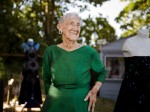 Britain's oldest fashion designer vows to continue making frocks aged 101