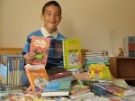 Seven year-old schoolboy is reading a book A DAY since he was five