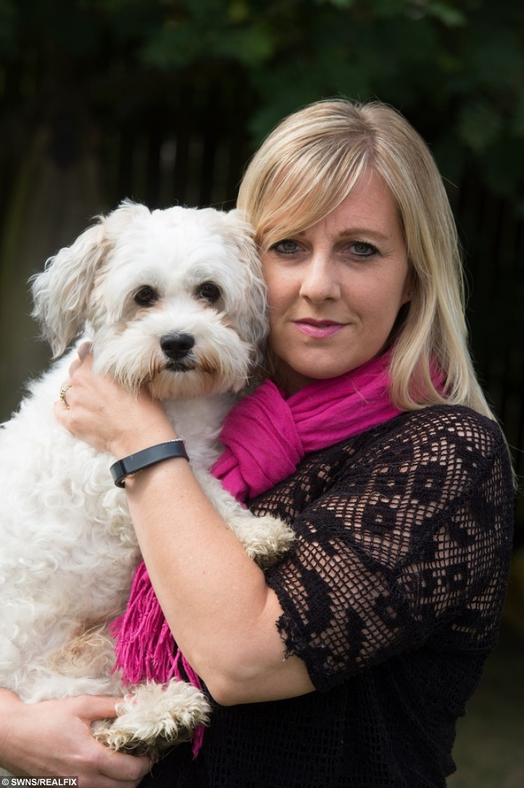 Kay Betson and her dog who had his testicles burned by a groomer at Pets at Home.
