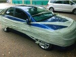 Man baffled after car is wrapped in clingfilm overnight