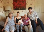 Family celebrating after welcoming fifth generation of first-born daughters