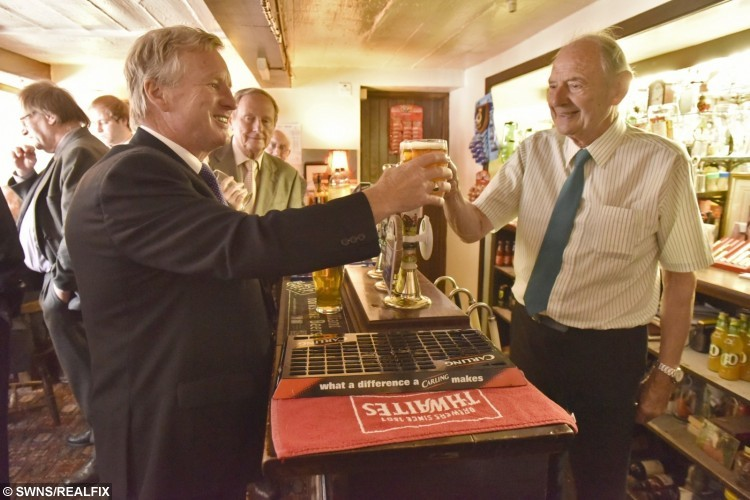 Frank Collins, 87, serving a pint at the Dog and Partridge near Huddersfield