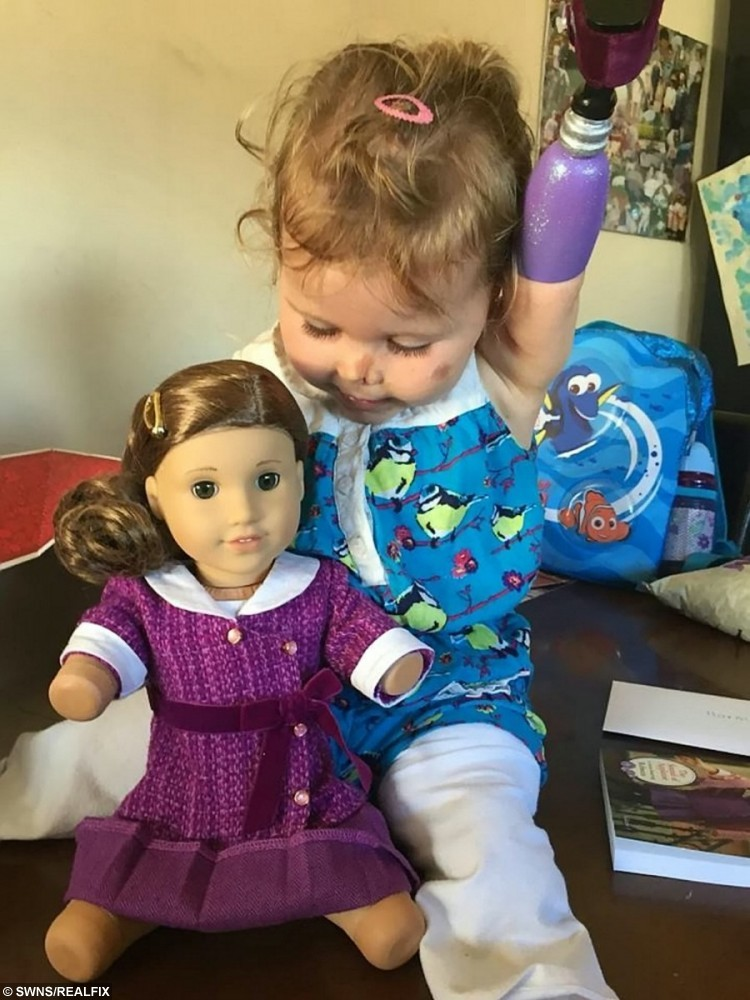 Meningitis victim Harmonie-Rose Allen with her new dol