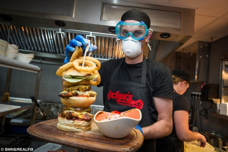 Jan Szymula age 28 head chef puts finnishing touches to the hot burger