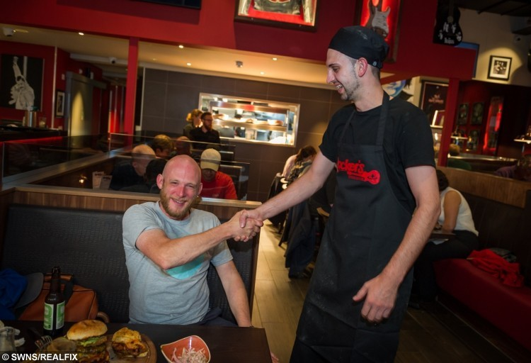 Rob Radcliffe age 36 takes on the hot burger challenge at Rocker's Stake House in Cambridge