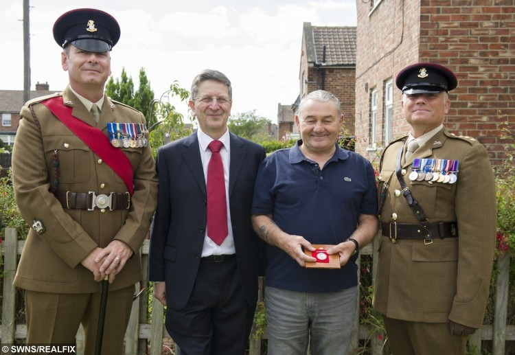 Bob Roulston receives the World War 1 medal of his great grandfather, Private Aaron J.