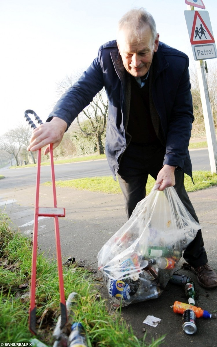 Mike Gibson picks up the litter along Clittaford Road, Southway