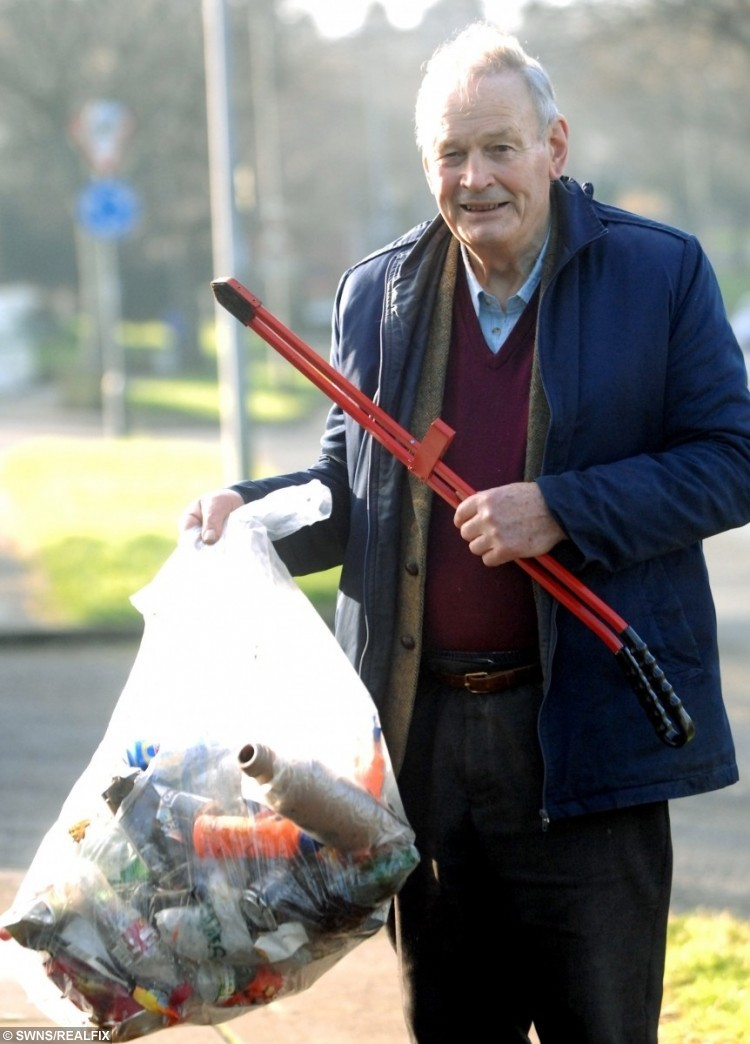 Mike Gibson picks up the litter along Clittaford Road, Southway.