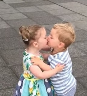 Adorable tots burst into laughter after sharing their first kiss