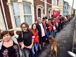 Hundreds of neighbours form human chain to prevent mum being kicked out of her home in 'revenge eviction'