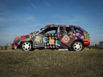 Two grans setting off for Rome in car covered in knitting