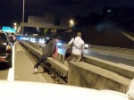 Shocking footage shows idiotic couple run across busy M25 as oncoming traffic races past