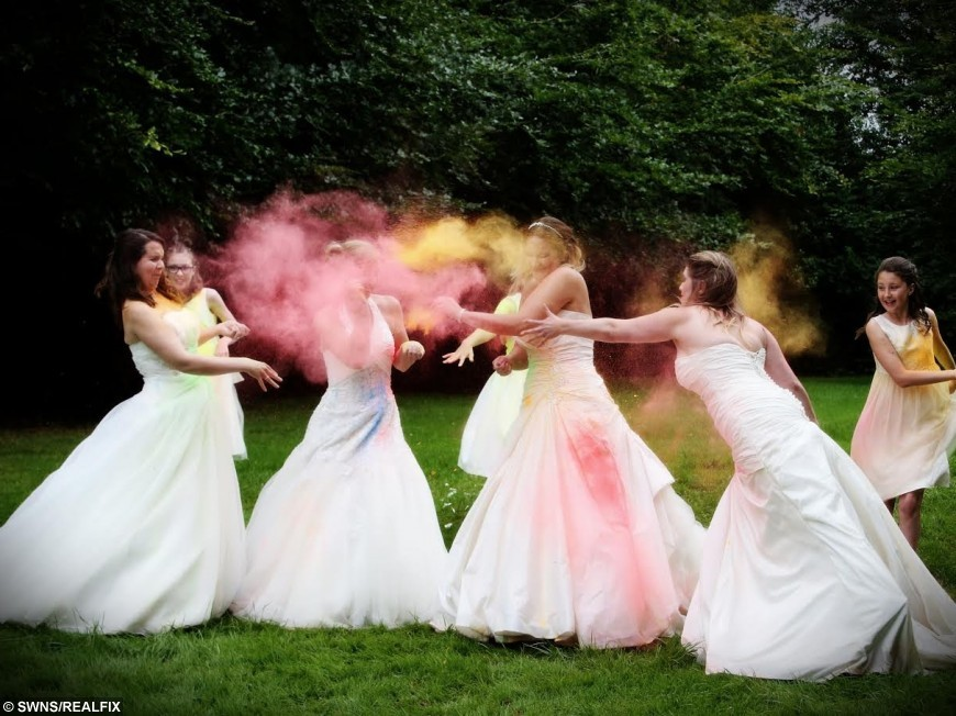 Brides trash their wedding dresses by throwing PAINT over each other ...