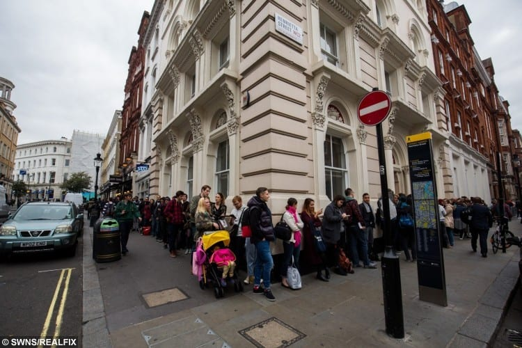 People queue outside of the Whole Glory room by tattoo artist Scott Campbell
