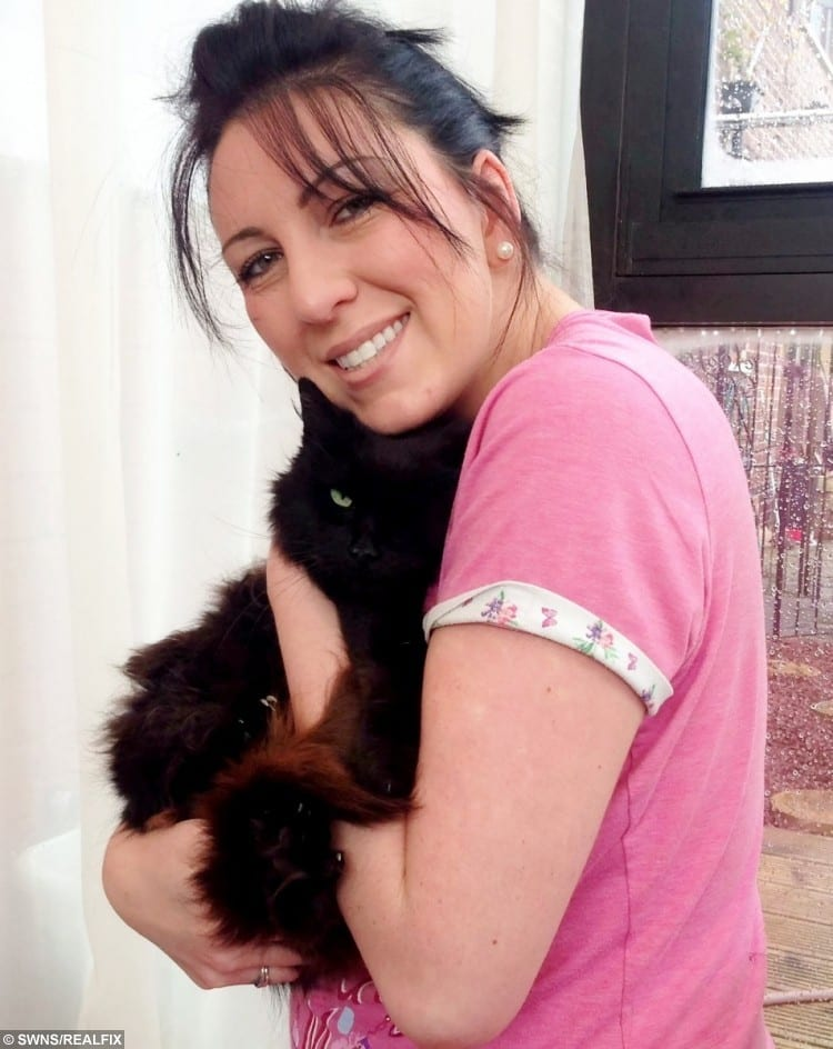 Terrie Mitchell, 34, of Sheffield, South Yorks., with her cat, Chloe after they were reunited