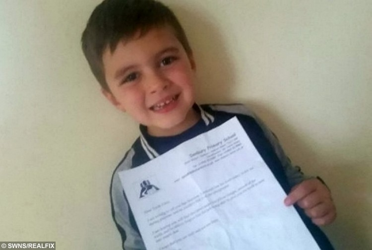 Harrison Townsend with the letter which headteacher Jamie Stone wrote to the tooth fairy