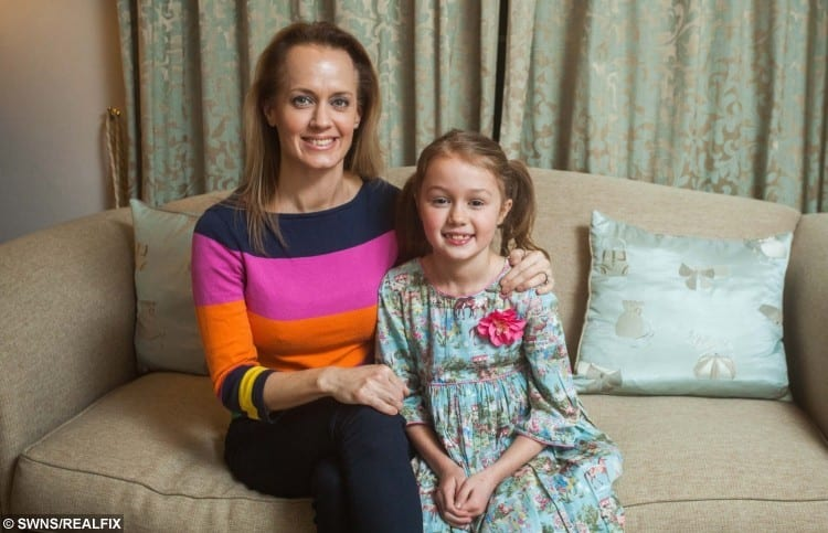 Emily Hall with her daughter Grace aged eight, at their home West Hill, Devon.