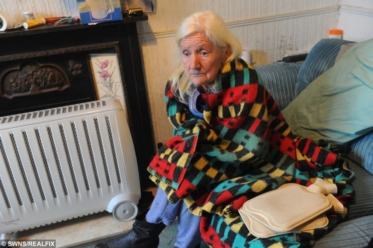 Shirley Walsh at her home on Kathleen Road, Hull, where she is forced to use electric heaters, hot water bottles and blankets to keep warm.