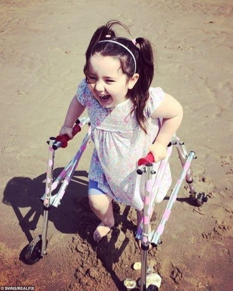 Freya Bailey, 6, who needs to raise 65k to have surgery to help her stand up.