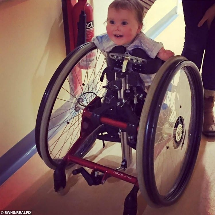Harmonie-Rose Allen using her wheelchair for the first time