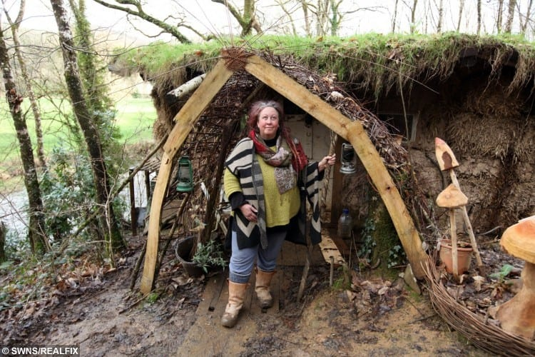Kate Burrows in her mud hut home near Chumleigh, Devon.