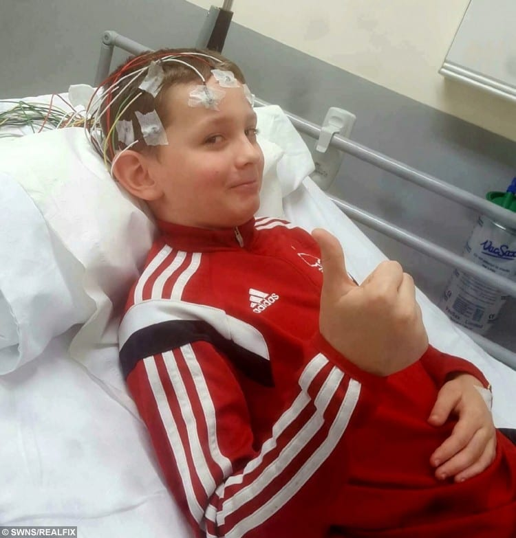 William Smedley, 11, of Ilkeston, Derbyshire, in hospital undergoing an E.E.G for his fits.